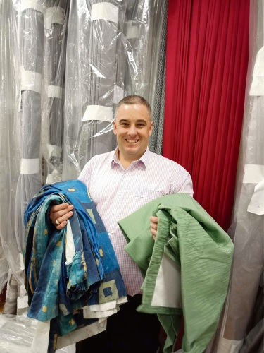 Décor Blinds and Curtains general manager Justin Griffiths with pre-loved curtains.