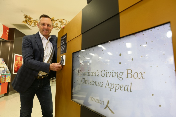 Russell Gibbs (CEO Hawaiian) at the Giving Box where people can donate food for Foodbank and Anglicare and for the first time make a donation via bankcard. Picture: Andrew Ritchie www.communitypix.com.au   d488887