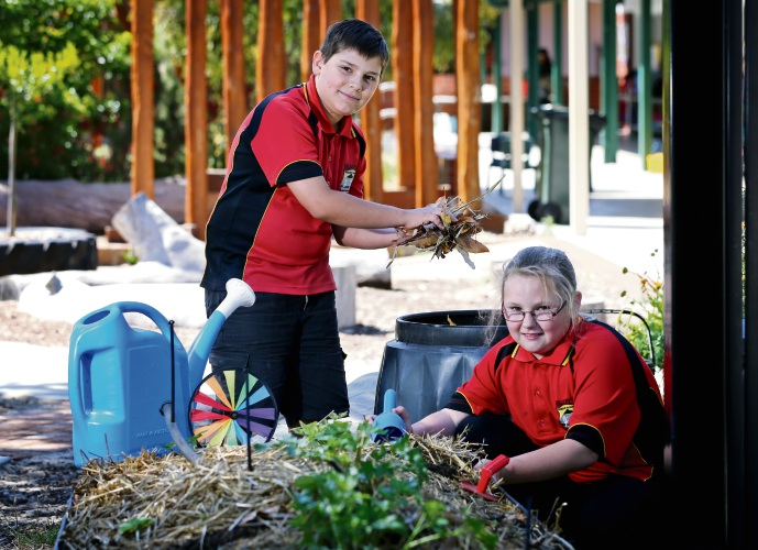Year 5 students L-R: Blerim Ramadani (11) of Morley and Kelly-Anne Stobie (11) of Bayswater, seen here at work in the school garden.  Hillcrest Primary School in Bayswater won the 2018 Waste Wise School of the Year award in November. Picture: David Baylis www.communitypix.com.au   d488819