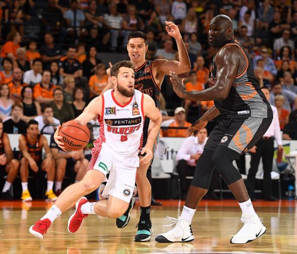 Mitch Norton drives to the basket against the Cairns Taipans. Picture: Getty Images