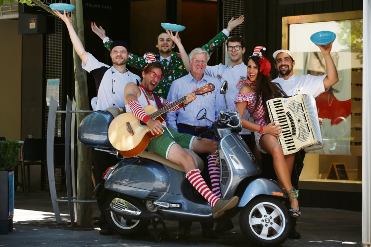 Claremont Mayor Jock Barker (centre) celebrates Buon Natale that starts Terrace Nights with (rear, l-r) Nolita Café's Andrew Tansley, Jason Stubbs, Federico Scotti and Gustavo Salto , and (front, l-r) Jungle Bello's Paisley Dee and Little Miss Squeezebox. Picture: Andrew Ritchie.