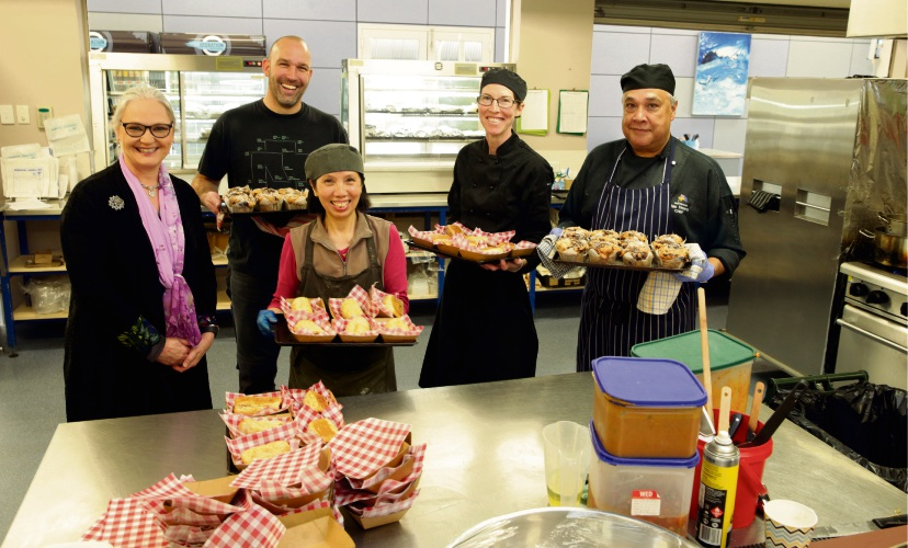 Principal Lea Fairfoul-Hutcheon, P&C president Oliver Wolf, canteen assistant Helen Johnston and chefs Emily Dos Santos and Ian Vears. Picture: Martin Kennealey.