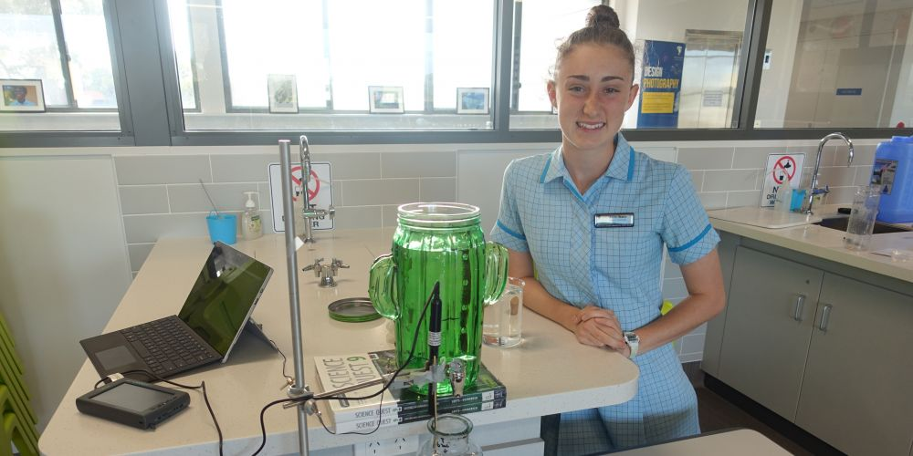 South Coast Baptist College student Anna Watts working on her problem, which looked at the sound spectrum produced from a vertical jet of water as it fills up bottles of different dimensions.