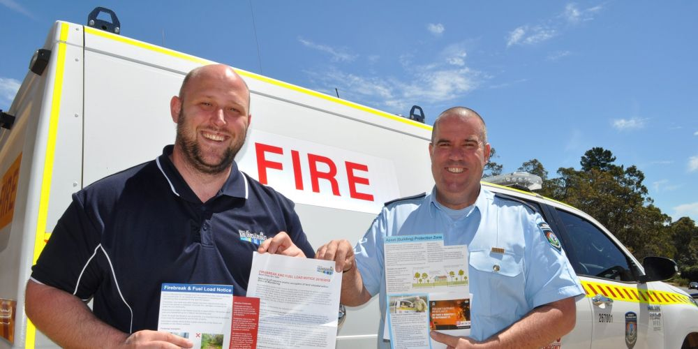 Community Safety and Emergency Management Co-ordinator Craig Cuthbert (Left) and Chief Bushfire Control Officer Jamie O'Neill (Right) hold this year's Burning Information Booklet and Firebreak and Fuel Load Notice. Included in this year's rates pack, these are useful materials for making your bushfire survival plan.
