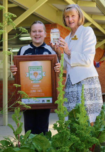 Ashburton Drive Primary School student Liliana Jones receiving the Young Re-inventor of the Year first prize certificate from City of Gosnells councillor Julie Brown.