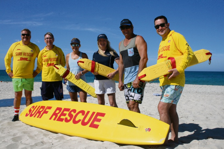 Members of Alkimos and Quinns Mindarie surf lifesaving clubs with Mayor Tracey Roberts.