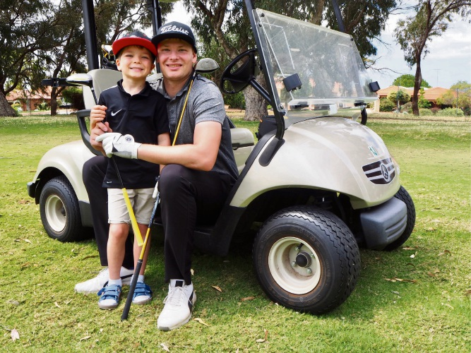 Mandurah YouTuber on the gold course with his son Adam.