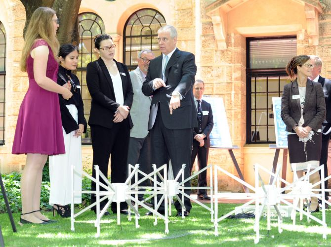 Prince Andrew (right) gets told about black holes by Dr Gemma Anderson at UWA this morning. Picture: Jon Bassett.
