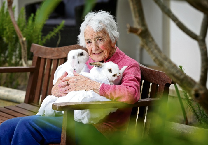 Mercy Place Lathlain resident Ivy Ballantine (99) with Harlow and Spotty. Picture: David Baylis.