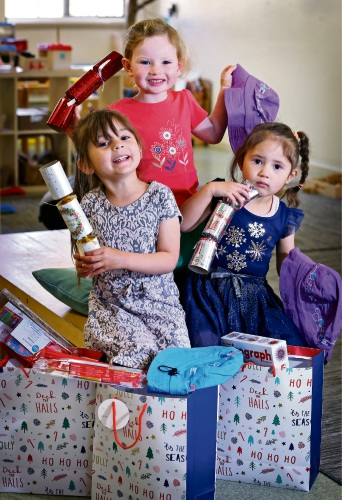 L-R: Emily Steinberger (5), Mya Brosnan (3) and Sidney Teale (3). Kids from Goodstart Early Learning Centre are calling on donations from parents, community members and businesses to form Christmas gift packs. The packs will be donated to a women''s refuge in time for Christmas. Picture: David Baylis www.communitypix.com.au d488816