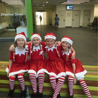 Four of the Red Dress Choir's youngest members.