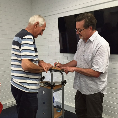 Fremantle author Alan Carter (right) signs his book for a fan.