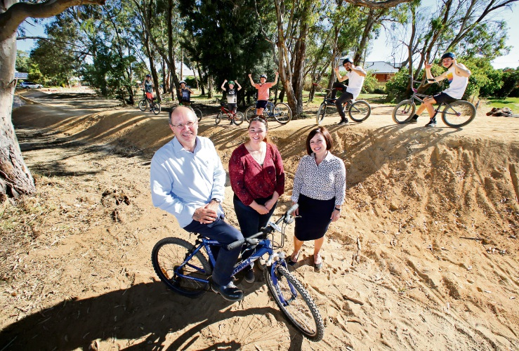 FRONT L-R: Cr Ian Johnson (City of Swan), local resident Melinda Brackley of Viveash and Cr Claire Scanlan (City of Swan).  The City of Swan is upgrading Stewartby Park in Viveash this month. There will be new BMX tracks and other amenities for users. The upgrade to the park, locally known as Viveash Jumps, includes a new gazebo, water fountain, an upgraded BMX track, logs around the park perimeter and new signage. Picture: David Baylis www.communitypix.com.au   d488859