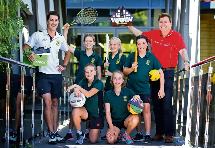 Physical education coordinator Kenrick Armitage, rear left, Eva Douglas (12), Lara Jordan (11), Eve Sargent (10) and Dr Garry Tester holding the perpetual trophy. Mya Richards (11, front left) and Hannah Slyth (12). Picture: David Baylis.