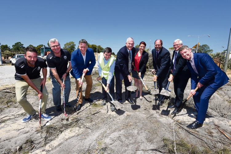 Logan Howlett (fifth from left) at the Lakelands Hockey and Community Facility sod turning. It will open in 2019. Photo: Jon Hewson. d488902 communiypix.com,au