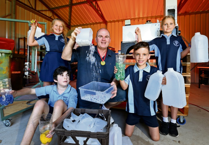 Chloe Ortin (10, left), Peter Dadd (11), parent Jamie Dadd, Mason Allan (7) and Heidi Marsh (9). Jamie Dadd is a parent at Chidlow Primary School and the architect of a recycling project called The Remake Place. Picture: David Baylis.