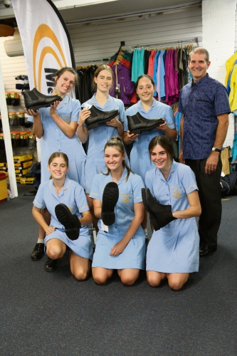 Iona Presentation College teacher Chris Girando with students who participated in the Boots appeal.