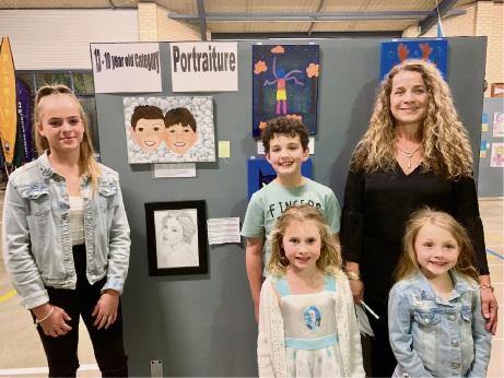 Art teacher Karen Greaves (right) with winners Paris Greaves, Ezra Whitford. Hayley Jensen and Eva Turnbull.