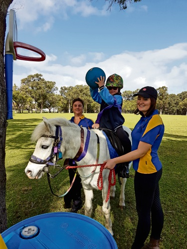 RDA Carine volunteers Whitney Saffron and Chloe Wildsmith with Faith Pascoe (12) and horse Percy.