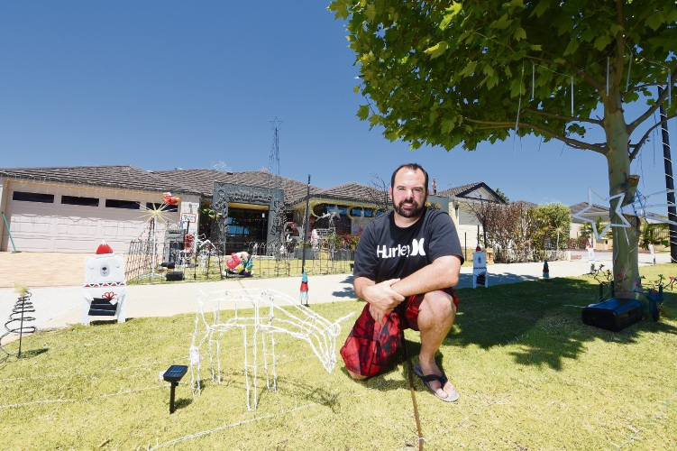 Clayton Reimers with his Christmas lights display out the front of his Aubin Grove House. Picture: Jon Hewson.