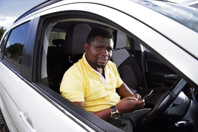 Uber driver Simon Baah (Koondoola). Photo: Martin Kennealey
