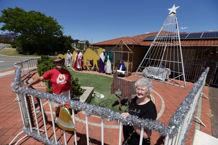 John and Sheila Ramsbottom prepare their Christmas lights display. Picture: Martin Kennealey www.communitypix.com.au d488689