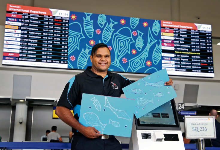Ellenbrook artist Justin Martin with his artwork 'Tondorup' at Perth Airport