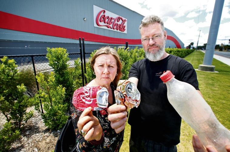 National Toxics Network Zero Waste Oz coordinator Jane Bremmer and Two Hands project coordinator Paul Sharp outside the Coca Cola plant in Hazelmere.