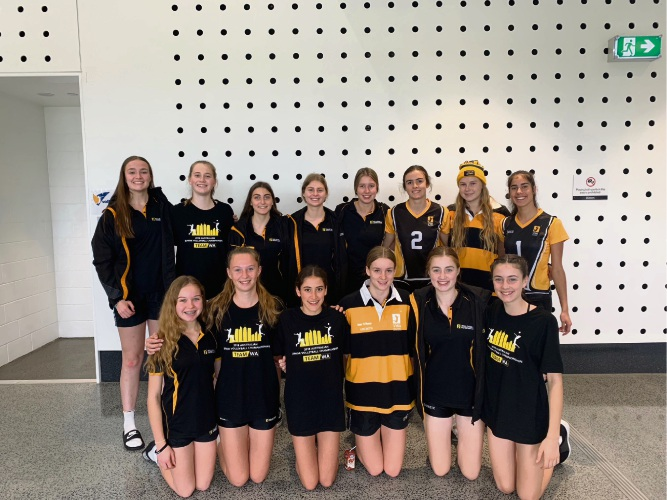 In striped jumpers, (BACK) Tessa Browne and (FRONT) Jess Burton with the Penrhos volleyball team players for the Australian Volleyball Schools Cup.