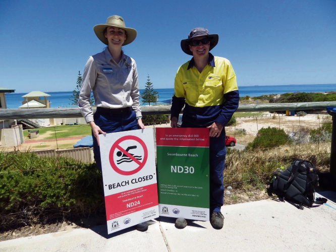 (L to R) City of Nedlands Ranger Jessica Bruce and Parks Supervisor Irrigation Nathan Deery with the BEN signs.