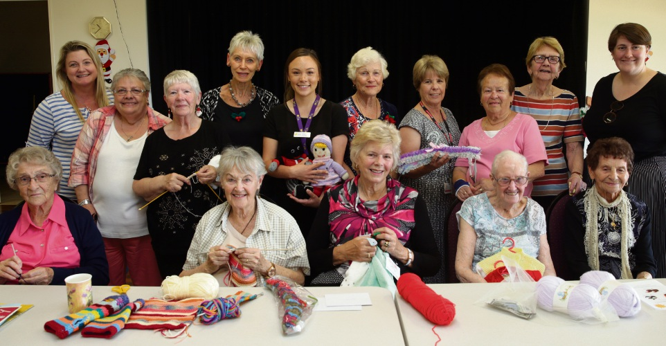 Ridgewood Rise craft group members and Cancer Council, Silver Chain and Rebecca West House representatives. Photo: Martin Kennealey d489319