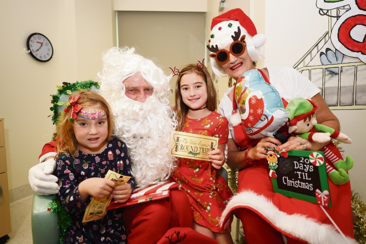 Santa and Mrs Claus with Melville residents Flora, 5, and Molly Hoole. Picture Jon Hewson.