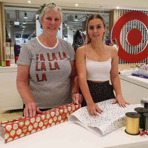 Soroptimist International Joondalup's Joan Bowey and volunteer gift-wrapper Chloe Sheridan at Ocean Keys Shopping Centre.