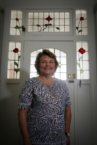 Andrea Hawkes at home in front of her leadlight window. The Subiaco Leadlight Night will resume on Friday, December 14. Picture: Andrew Ritchie.