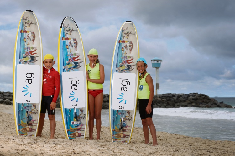 Boards donated to surf clubs will help Cooper Webb, left, Madison Turnbull and Trent Yates nip about in the surf. Picture: Andrew Ritchie.