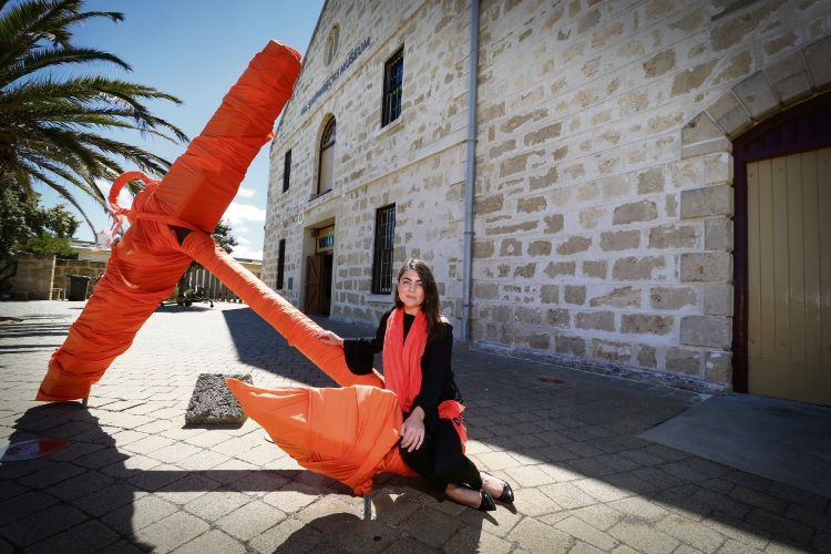 Site Manager of Fremantle Museums Gill Harrison next to the anchor covered in orange ribbons. Photo: Andrew Ritchie. d489222 communitypix.com.au.