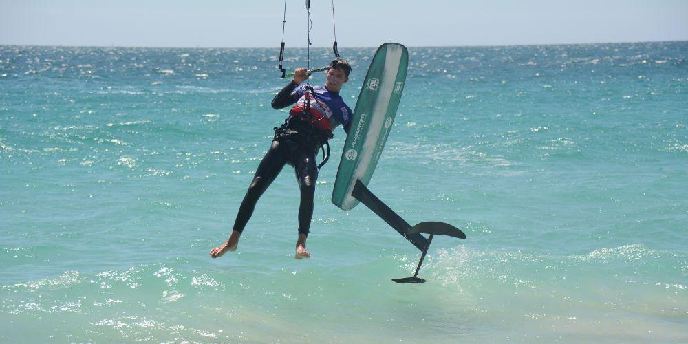 British kiter Guy Bridge dismounts his kitefoil after beating the record. Picture: Jon Bassett.