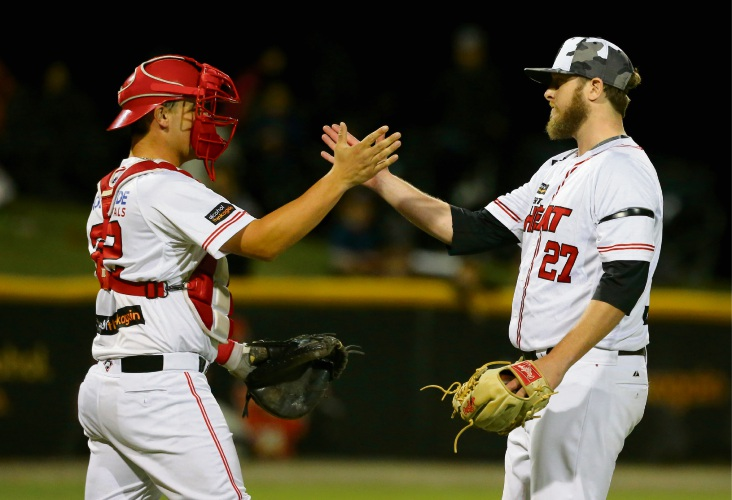 Cameron Lamb (right) celebrates with Chris Betts (left) after helping the Heat secure a series split.