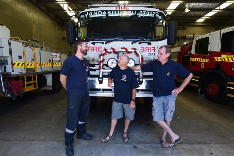 Volunteer firies Will Fogarty, Bob Haddrell and Steve Goedecke have returned from battling bushfires in Queensland. Photo: Jon Hewson. d489424 communitypix.com.au.