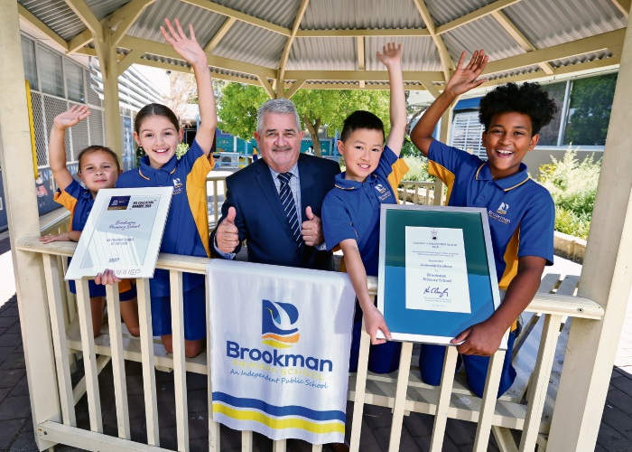 L-R: Laila Mitchell (7) of Langford, Olivia Corbett (9) of Langford, Hans Geers (Principal, Brookman Primary School), Michael Qua (10) of Thornlie and Agazi Gebrehiwot (10) of Thornlie. Picture: David Baylis