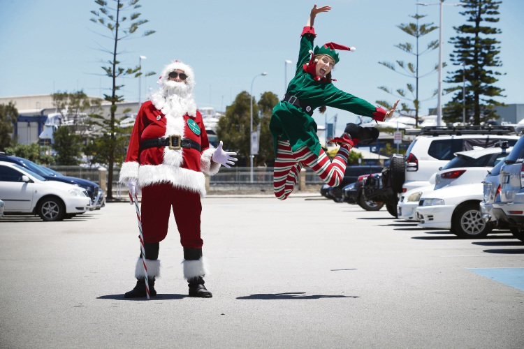 Santa and Elfie giving out free parking to visitors in Fremantle. Photo: Andrew Ritchie
