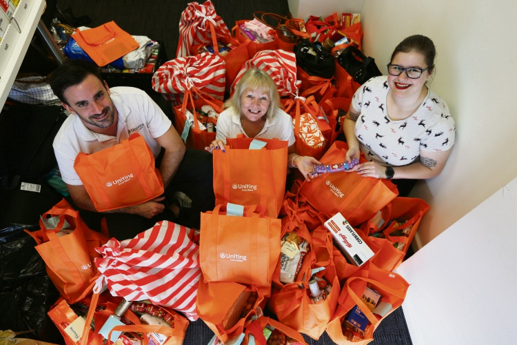 Ben Dettmer (Team Leader), Di Const (Admin) and Kate Henning (Christmas Appeal Coordinator) There's unprecedented demand for food hampers this Christmas and UnitingCare West urgently needs support. Picture: Andrew Ritchie