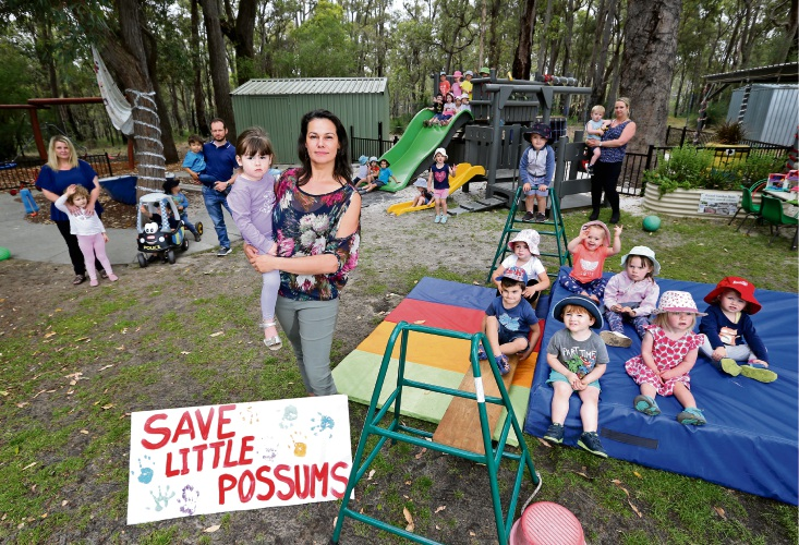 Kelly Oliver, of Stoneville, with her two-year-old daughter Charlotte, at the rally to keep Little Possums open. Picture: David Baylis