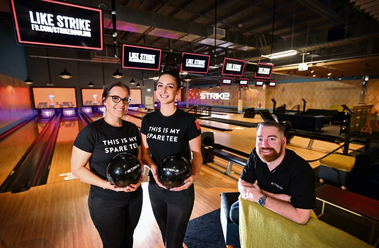 L-R: Strike Bowling staff members Sara Stanford-Bluntish and Taylor Payne with Manager Liam Boulter at the new Strike Bowling centre at Westfield Carousel Shopping Centre.