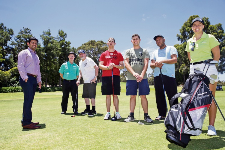 St Judes Disability Services managing director Binu Joseph and club head professional Rob Farley with St Judes clients John Penny, Nicholas and Thomas Berry and Henry Ryder and club professional Bronte Colbert. Picture: Martin Kennealey d489334