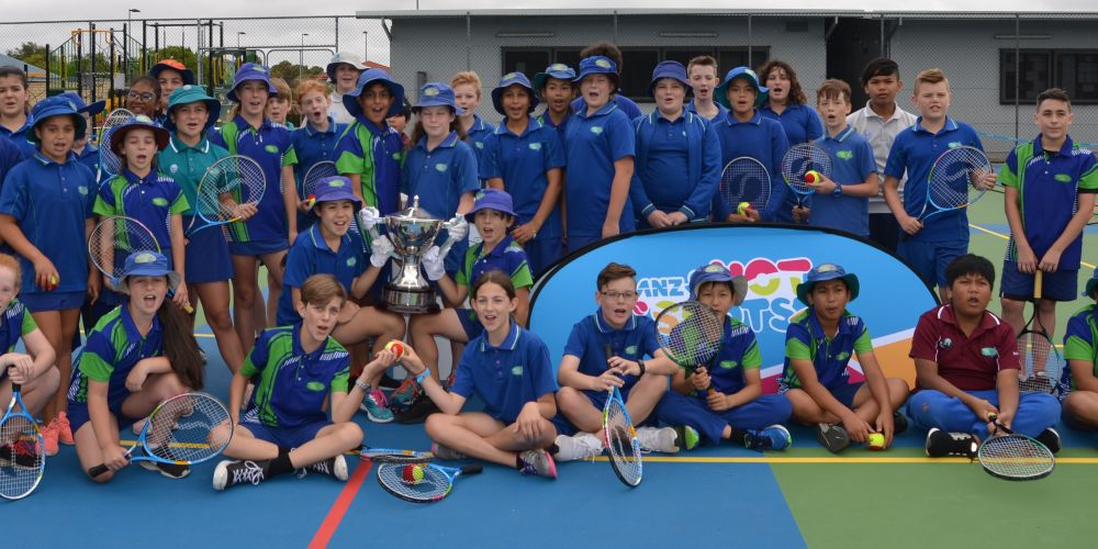 Yajat Sharma holds the Hopman Cup Trophy as part of Bertram Primary School's court resurfacing celebration.