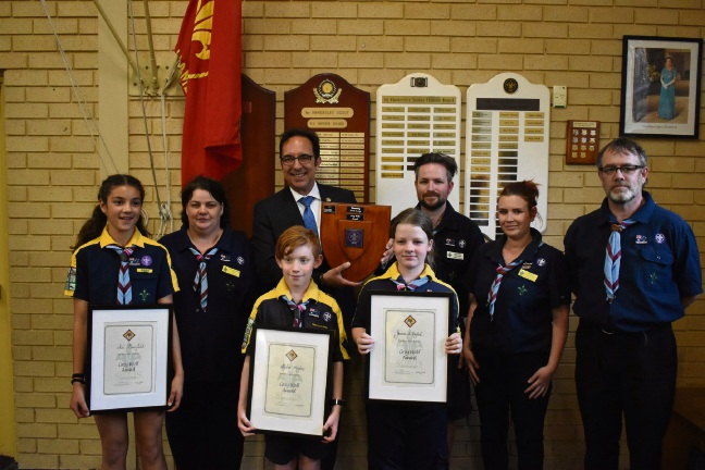 Ava Dransfield, Dylan Maybee and Jasmine de Bomford with their Grey Wolf certificates and Stirling Councillor Karlo Perkov and scout leaders. Photo: Adrianne van Munster