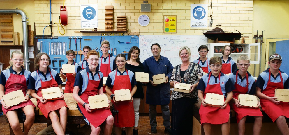 Year 8 students with design and technology teacher John Siciliano and Sue Harris and Carolyn Baird OAM from Carolyn and the Community.