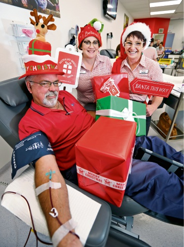 L-R: Blood donor Neil Dreyer of Morley (Giving blood for the 127th time) with Morley Donor Centre staff Kate Tomlin (Session Leader) and Heather Clarke (Enrolled Nurse). Photo: David Baylis