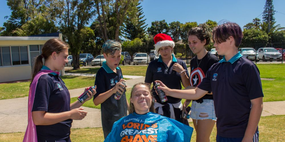 Safety Bay students Madison McDougall (Year 8), Aidan Bonner (Year 8), Kiara Fradl (Year 7), Jessica Harris (Year 10) and Zachary Argent (Year 8) about to colour teacher Irene van Zelst's hair.